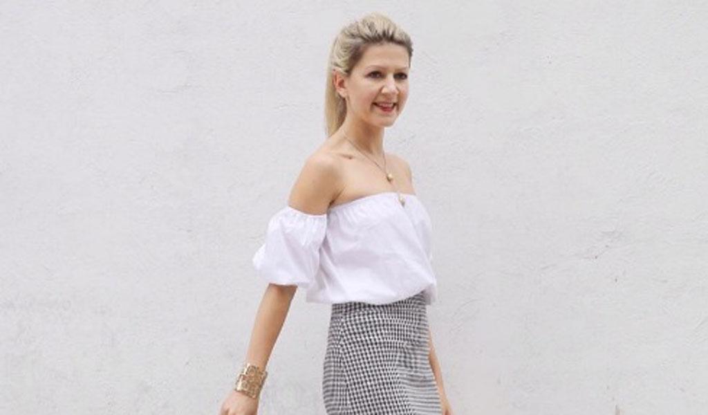 Camisa blanca en la falda