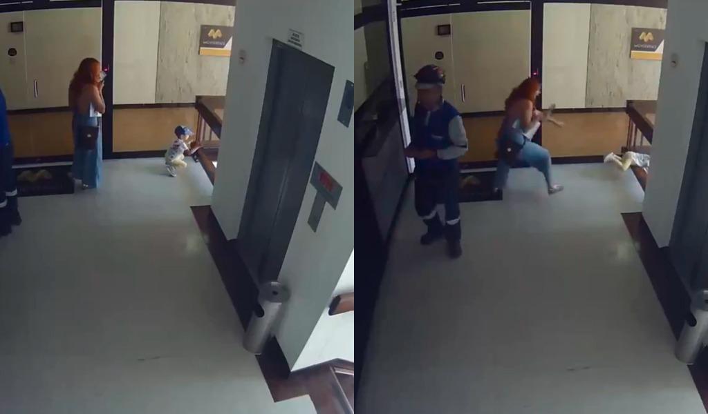 Mujer salva a niña a punto de caer en edificio